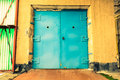 Old industrial building, a closed elevator door Royalty Free Stock Photo