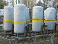 Old industrial chemical storage tanks Stock Photo