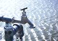 Old industrial faucet with water Royalty Free Stock Photo