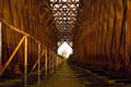 Old industrial railway railroad iron bridge center perspective n Royalty Free Stock Photo
