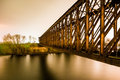 Old industrial railway railroad iron bridge in the night Royalty Free Stock Photo