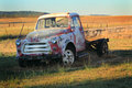 Old international harvester pickup an abandoned left retired in a golden field Royalty Free Stock Image