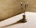 Old iron candlestick holder on table Royalty Free Stock Photos