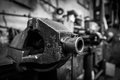 Old iron clamp in industrial interior Stock Image