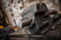 Old iron clamp in industrial interior Stock Photography