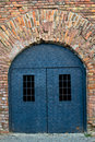 An old iron door in an old brick fortress wall Stock Image