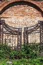 Old iron gates on a brick masonry Royalty Free Stock Photo