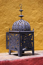 Old iron handcrafted lamp Stock Photography