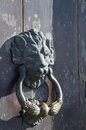 Old iron handle in the shape of lion Royalty Free Stock Photo