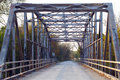 Old Iron Metal Truss Bridge on country road Royalty Free Stock Photo