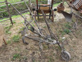 Old iron plow and other agricultural tools