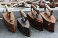 Old irons on asphalt there are behind them various steel subjects lie Royalty Free Stock Photography
