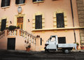 Old italian car parked in a historic building an is the piaggio ape for bee sometimes referred to as ape piaggio apecar Royalty Free Stock Photography