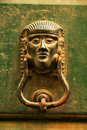 Old Italian door knocker on green wood Royalty Free Stock Photos