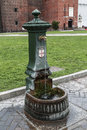 Old Italian outdoor water tap in the castle of Sforza, Royalty Free Stock Photo
