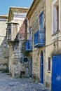 Old italian village buildings typical architecture and a narrow alley Royalty Free Stock Image