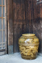 Old Japanese glazed earthenware or ceramic jar with dragon pattern design used as water container Royalty Free Stock Photo