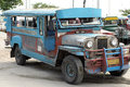 Old jeepney bus angeles sapangbato philippines jan jeepneys serving the to route on jan in jeepneys are popular and cheap form of Stock Photography