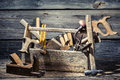 Old joinery tool box on wooden table Royalty Free Stock Photo