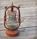 Old kerosene lamp retro on a wooden table Stock Photography