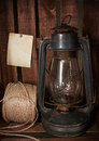Old kerosene stove and a roll of twine on rustic background in vintage style Royalty Free Stock Photography