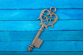 Old key on a blue background Royalty Free Stock Photo