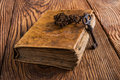 Old key with book Royalty Free Stock Photo