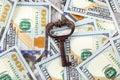 Old key on money background Royalty Free Stock Photo