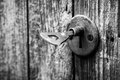 Old key in a rusted door lock closeup of an keyhole with on wooden antique Royalty Free Stock Images
