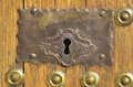 Old keyhole rusty and aged in an wooden door Royalty Free Stock Photography