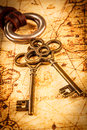 Old keys on an ancient world map Royalty Free Stock Images