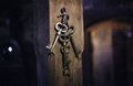 Old keys on a column, antique wood background Royalty Free Stock Photo