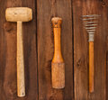 Old kitchen utensils on a wooden background Stock Image
