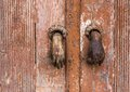 Old knocker bronze on a wooden door Royalty Free Stock Photo