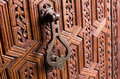 Old knocker in  wooden door Royalty Free Stock Photo