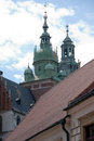 Old krakow view red tiled roofs and green spire of castle cathedral Stock Photos