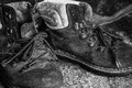 Old laced up boots closeup of a worn pair of black and white Stock Photography