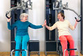 Old Ladies Exercising While Touching their Palms Royalty Free Stock Photo