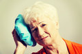 An old lady with ice bag by her head Royalty Free Stock Photo