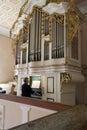 Old lady playing medieval church organ Royalty Free Stock Photo