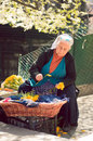 Old lady selling flowers Royalty Free Stock Photo