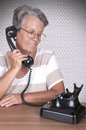 Old lady talking on old phone vintage Royalty Free Stock Images