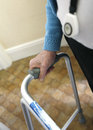 Old lady using a walking frame pensioner for mobility Stock Image