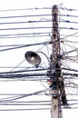 Old lamp on electricity pole and chaotic tangle of wires Stock Photo