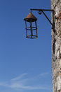 Old lamp and a wall on stone in the medieval village of perouges Royalty Free Stock Photo