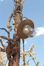 Old lamp on wooden post over blue sky Stock Images