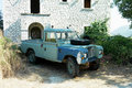 Old landrover defender abandoned greece Royalty Free Stock Photo