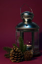 Old lantern with candle and cones Stock Image