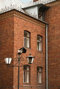 Old lantern in a court beautiful brick house broken Stock Photo