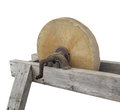 Old large grinding wheel isolated hand turned stone in a wooden frame on white Royalty Free Stock Photos